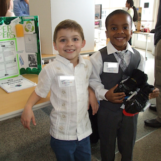 InVenture Prize - two students pose in front of their project